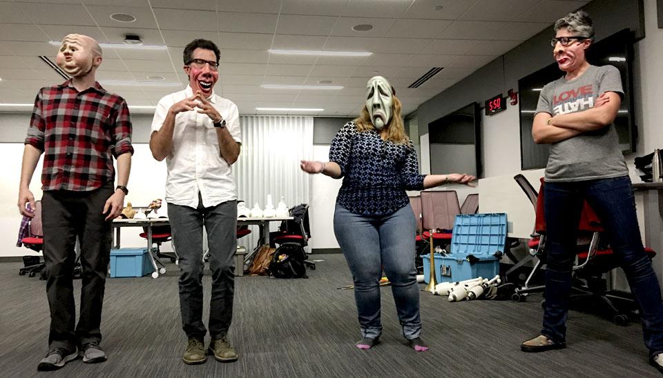 Group workshop with performance masks