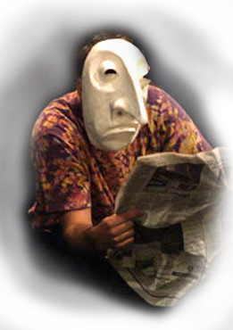 Jacob Mills - acting with mask, reading paper