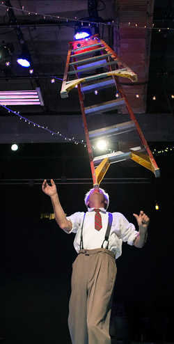 Ladder balanced on chin in a Chicago vaudeville performance
